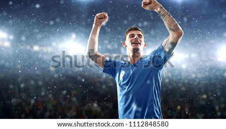 Soccer player celebrates a victory on the professional stadium while it's snowing. Stadium and crowd are made in 3D.