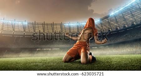 soccer player celebrating a goal on a soccer stadium #623035721