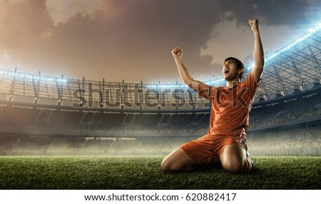 soccer player celebrating goal on a soccer field during the match #620882417