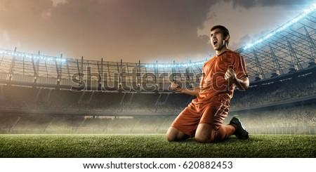 soccer player celebrating goal on a soccer stadium