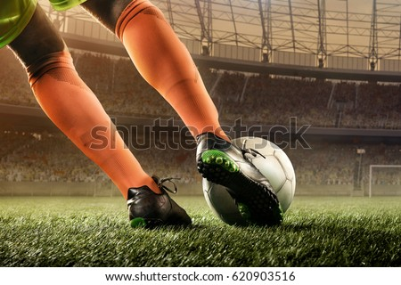 soccer player hits a ball #620903516