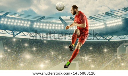 Soccer player in action. Flying headed shot. Soccer stadium with bright lightning