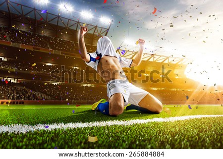 Stock Photo Soccer player in action on night stadium panorama background