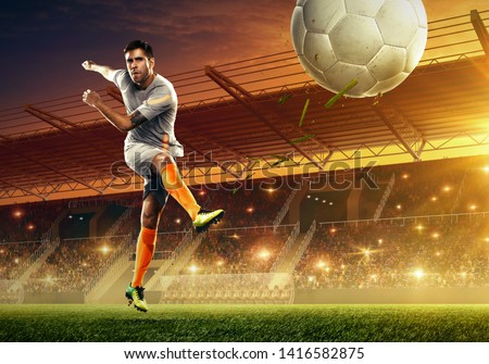 Soccer player in action. Professional soccer arena