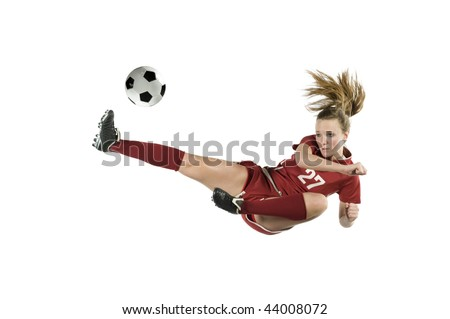 Soccer player in the air kicking the ball