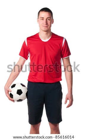 soccer player is holding ball isolated on white