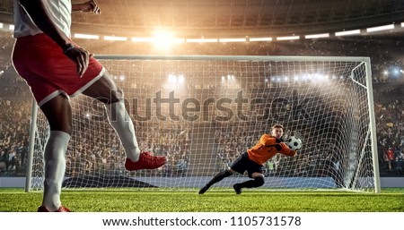 Soccer player is trying to score a goal while goalkeeper defends on a professional soccer stadium. Stadium and crowd are made in 3D.