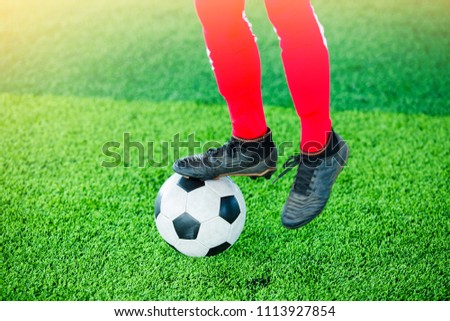 Soccer player jump and stomp for training to trap and control football.
