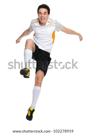soccer player jumps up and shouts with joy