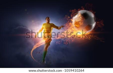 Soccer player kicking ball. Mixed media #1059410264