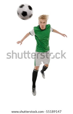 Soccer player kicking the ball isolated on white