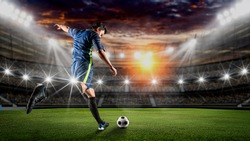 Soccer player kicks the ball on the soccer field.Professional soccer player in action.