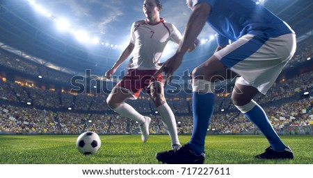 Soccer player kicks the ball on the soccer stadium. He wear unbranded sports clothes. Stadium and crowd made in 3D.