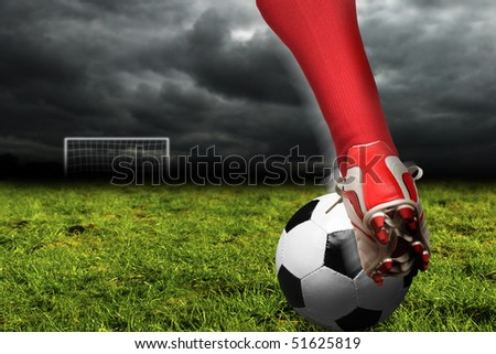 soccer player legs with ball on a pitch