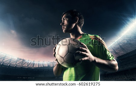 soccer player on a field with a ball  #602619275