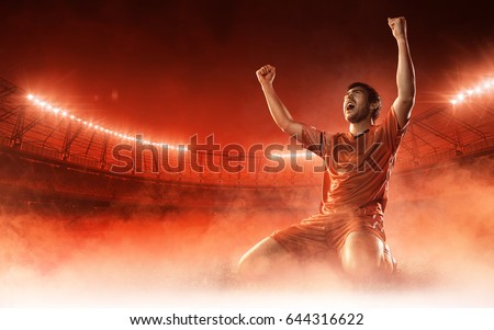 soccer player on soccer stadium celebrating a goal on red smoke background #644316622