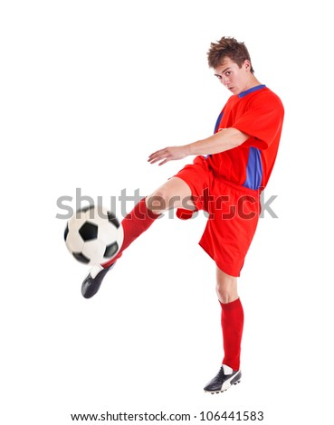 Soccer player shooting a ball isolated on white background