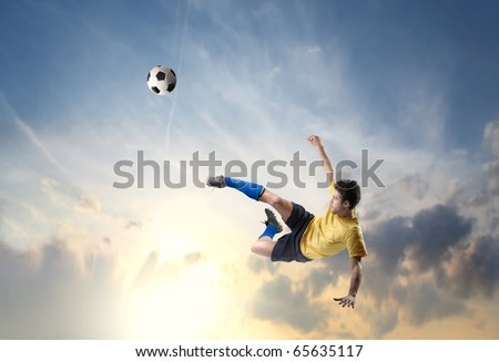 Soccer player shooting a football