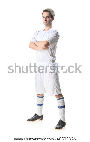 Soccer player standing isolated on white background