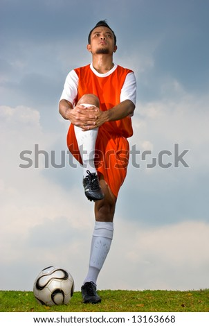 Soccer player warming up before the game start