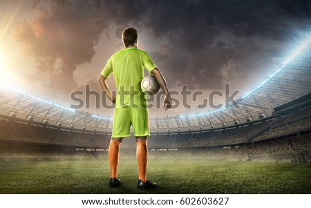soccer player with a ball  #602603627