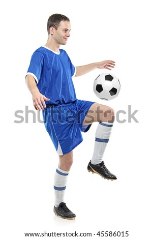 Soccer player with a ball isolated against white background
