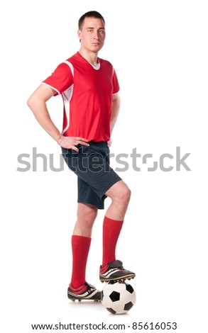soccer player with ball full length isolated on white