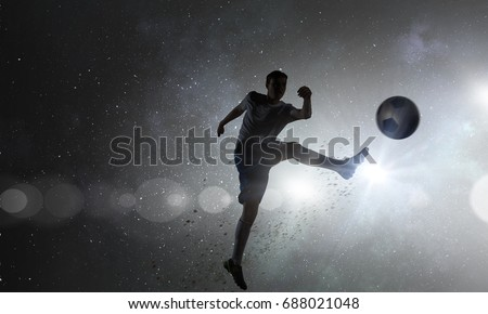 Soccer player with ball outdoors