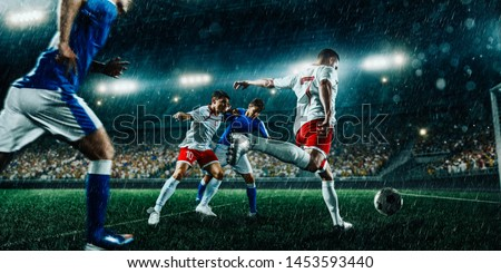 Soccer players in action on  professional soccer stadium