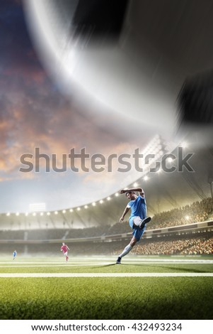 Stock Photo Soccer players in action on sunset stadium background