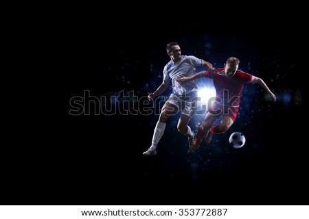 Soccer players in action over black background