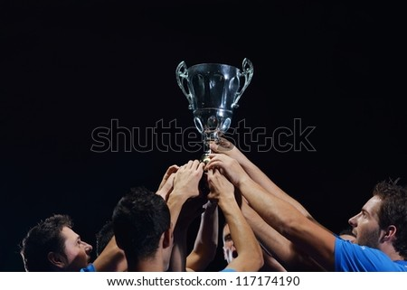 soccer players team group celebrating the victory and become champion of game while holding win coup