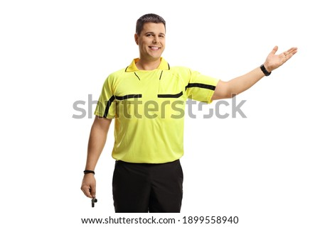 Soccer referee holding a whistle and pointing with hand isolated on white background