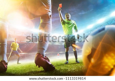 Soccer referee showing a red card