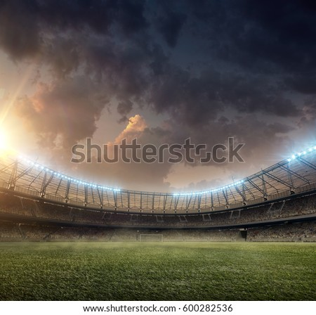 soccer stadium with green grass and tribunes #600282536