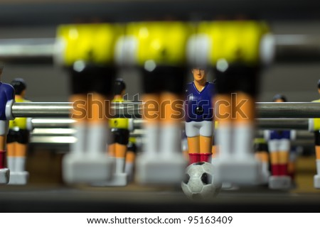 soccer table, close up three figures standing in front of the goal