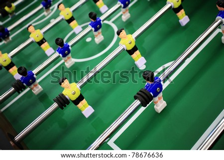 Soccer table game with yellow and blue players