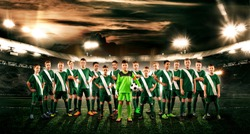 Soccer team. Kids - future champions. Boys in football sportswear on stadium with ball. Sport concept.