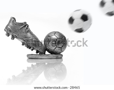 Soccer trophy - 2 soccer balls with motion blur added.