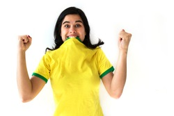 Soccer woman celebrating on yellow uniform isolated on white background. Beautiful woman happy and cheering.