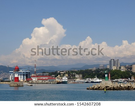 Sochi port against the sky of mountains and cumulus clouds #1542607208