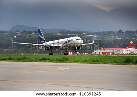"SOCHI,RUSSIA-AUG16: Boeing-757-200 of  ""Yakutia"" airlines on rise on August 16,2012 in Sochi, Russia. In 2012 ""Yakutia"" flies to 11 destinations within the program of subsidized transport"