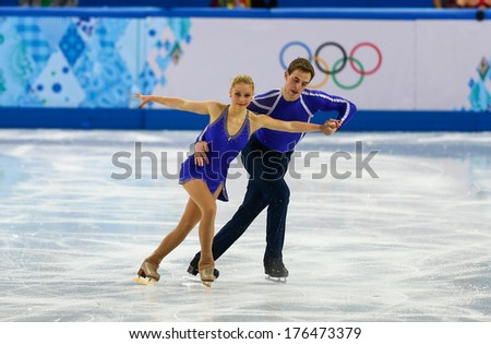 Sochi RUSSIA February 11 2014 Julia LAVRENTIEVA and Yuri RUDYK UKR on ice during figure skating competition of pairs in short program at Sochi 2014 XXII Olympic Winter Games