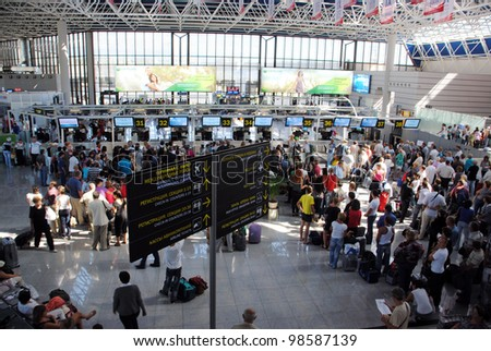 SOCHI, RUSSIA-SEPTEMBER 16: People in waiting room at International Sochi airport, which takes the 8th place in Russia on a passenger traffic whith more than 2 mln passengers a year September 16, 2010