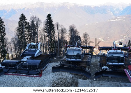 Sochi, Russia: Silver gray ratrak on the snow-covered slope of Caucasus mountains in Sochi. Ratrak are used to prepare slopes for skiers and for the docking of mountaineers. #1214632519