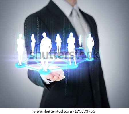 social and business concept - close up of mans hand showing social or business network