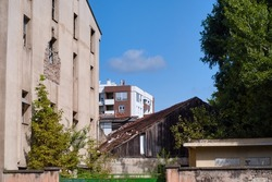 Social contast of growing city of Novi Sad, Serbia - historical poor house and new high rise building