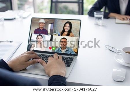 social distancing concept, businessman talking to colleagues about plan in video conference in house, meeting and planning online as covid 19 or corona virus disease