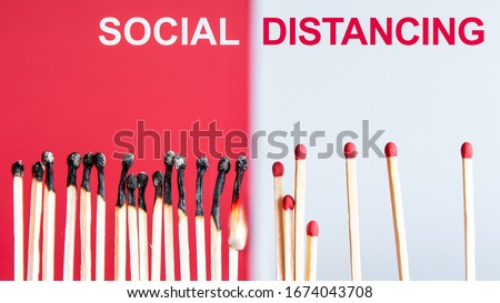Social Distancing concept using burnt out match sticks as a metaphor for containing corona virus outbreak - health and medical concept image with copy space for text.