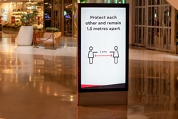 Social distancing information at the shopping centre. Protect each other and remain 1.5 metres apart. Covid-19 outbreak